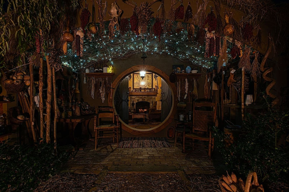A 'Lord Of The Rings' Airbnb in Fairfield, Virginia is illuminated at night with twinkly lights and a cozy fireplace.