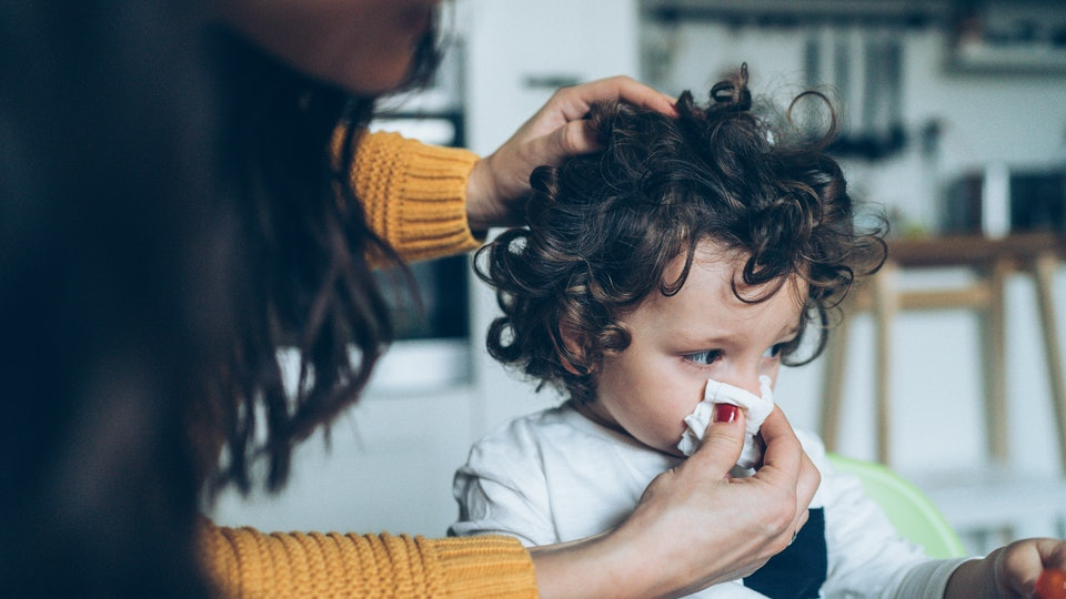 Mom blows toddler's nose
