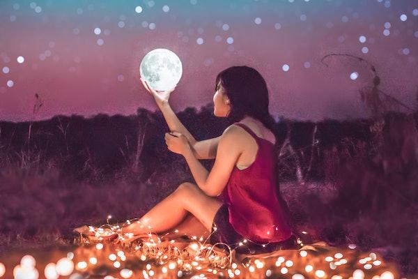 Girl holding supermoon