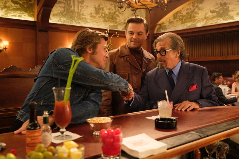 Brad Pitt as Cliff Booth, Leonardo DiCaprio as Rick Dalton, and Al Pacino as Marvin Schwarz drinking at a bar in Once Upon a Time ... in Hollywood