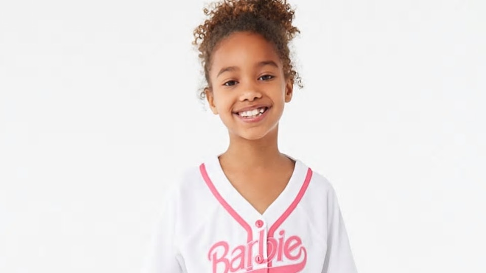 a girl wearing the forever 21 Barbie collection