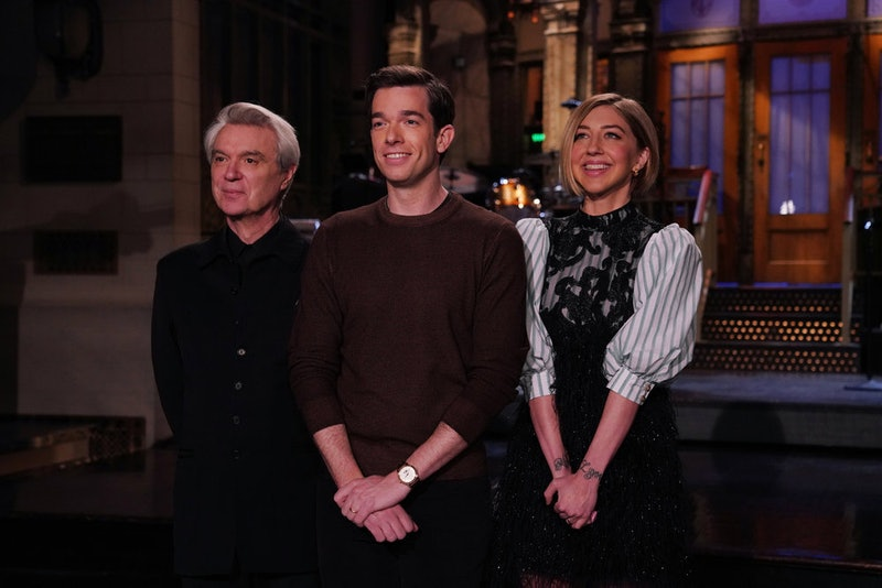 Musical guest David Byrne, host John Mulaney, and Heidi Gardner on Saturday Night Live