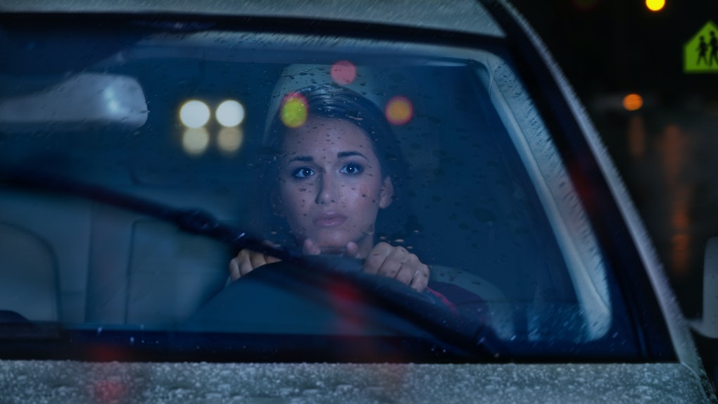 Young woman in car on Friday the 13th