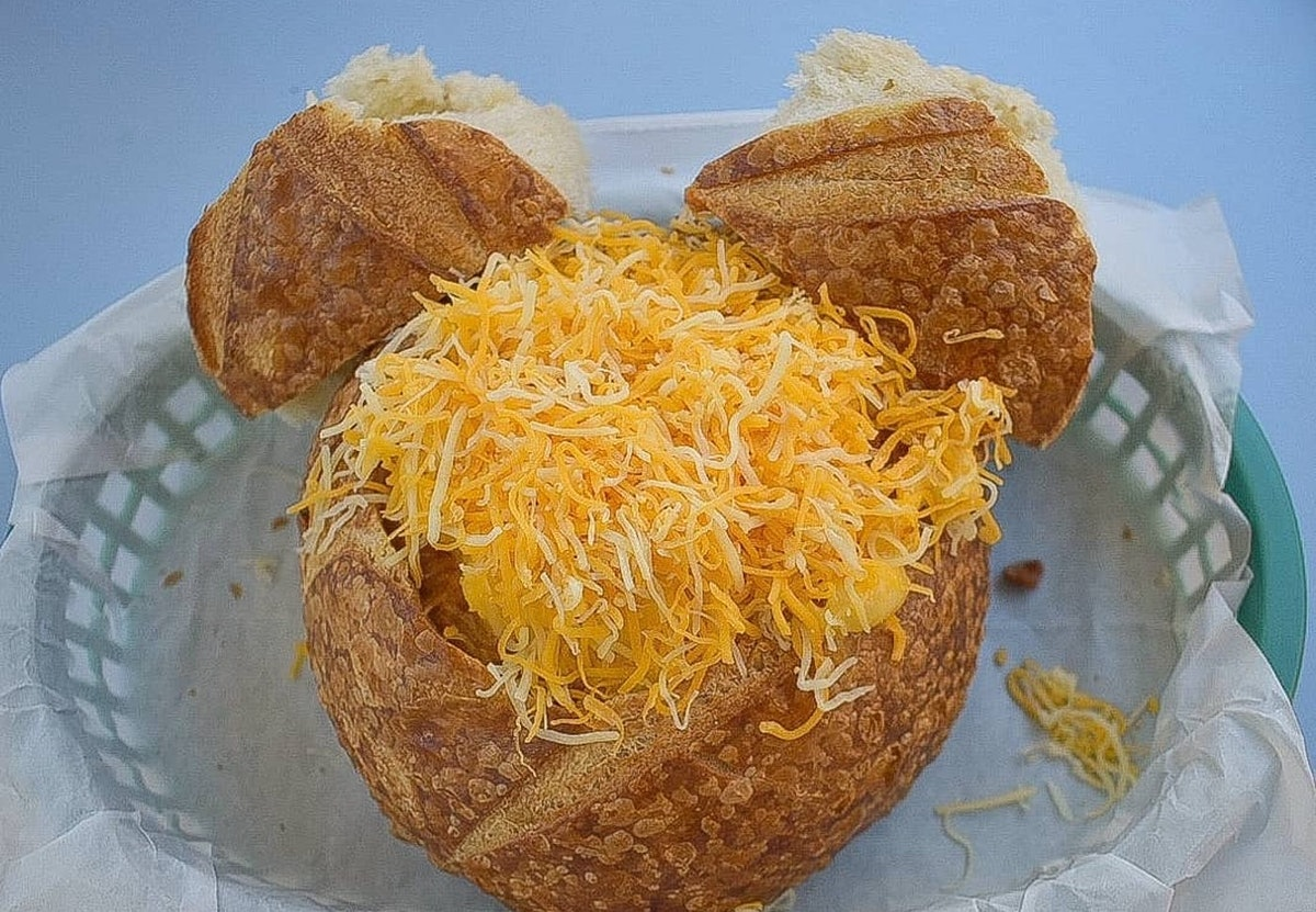 An off the menu chili mac 'n' cheese in a Mickey Mouse-shaped bread bowl sits on a table at Disneyland.