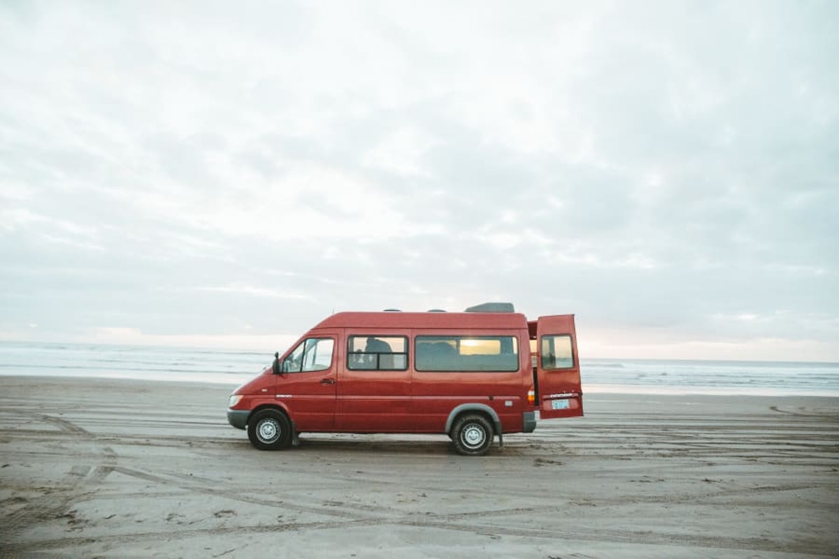 A 2004 Dodge Sprinter Motor Home sits on the beach in Oregon.