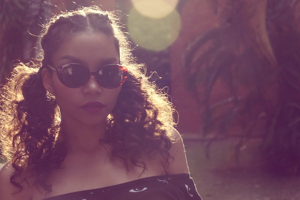 Young black woman wearing sunglasses