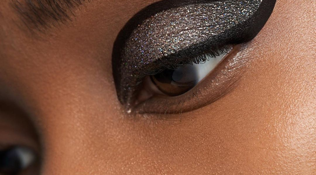 Woman with matte black and glitter eyeshadow