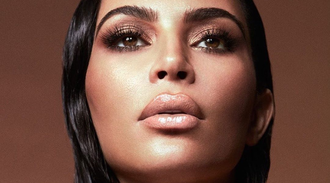 Kim Kardashian poses in a promotional photo for KKW Beauty's New Classic II Collection launching March 20 with new eyeshadow and lip gloss