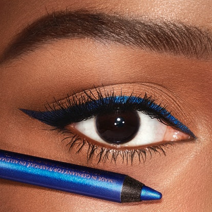 Woman with brown eyes and blue eyeliner