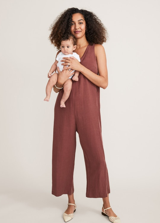 a woman holding her baby wearing clothes from HATCH's fourth trimester collection