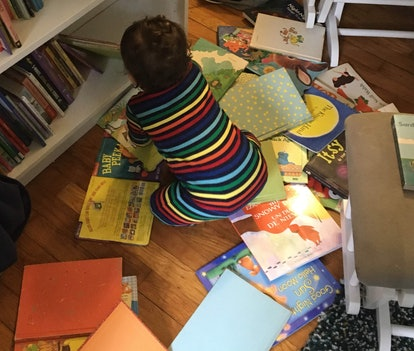 why do books calm my toddler down, toddler sitting in a pile of books