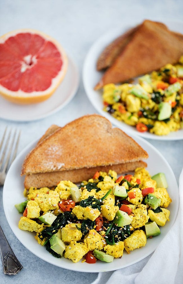 A picture of scrambled tofu with greens and avocado.