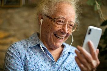 Cheerful senior woman making a video call