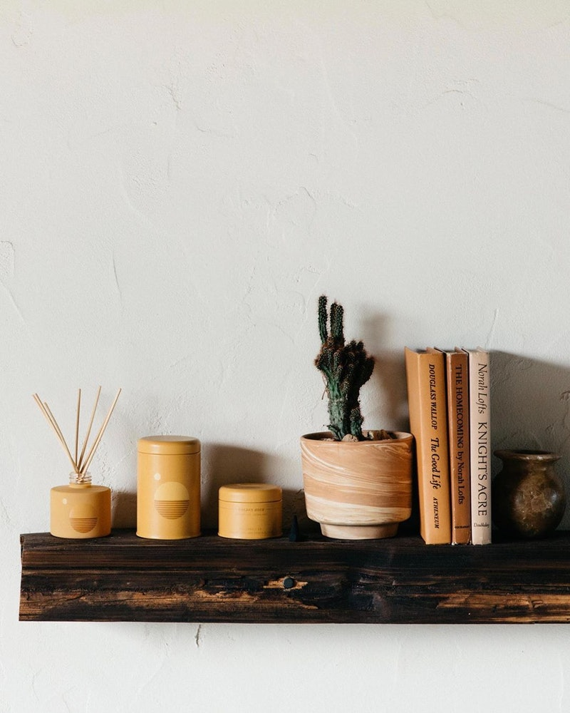 P.F. Candle Co. is one company that offers cozy, relaxing candles that can help warm up your home
