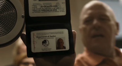Dean Norris as Hank Schrader holding his DEA identification on Better Call Saul