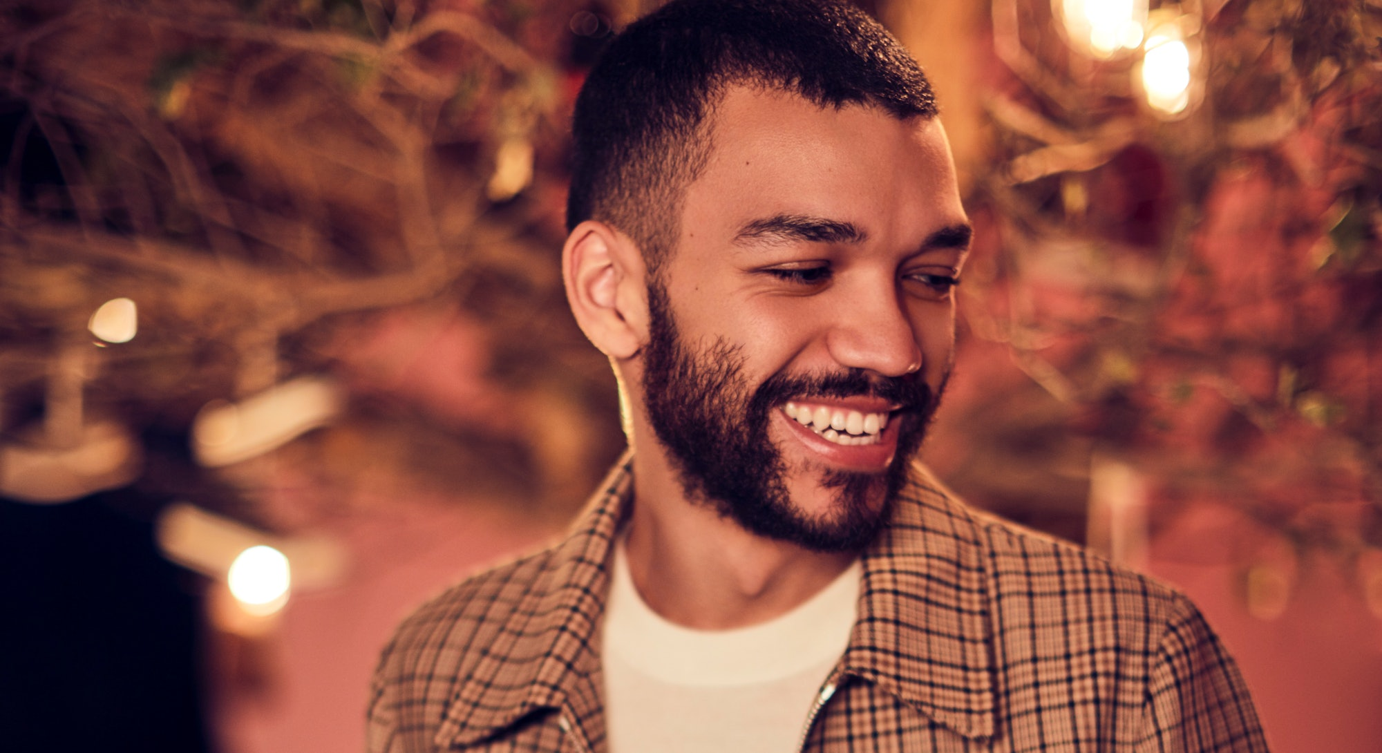 Justice Smith in plaid jacket