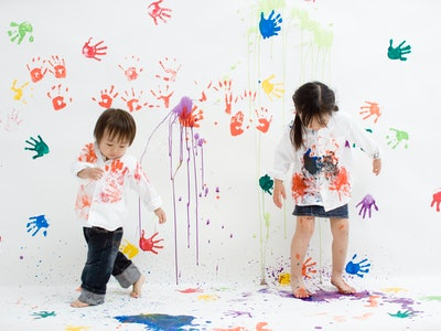 Children play with hand prints and finger paint