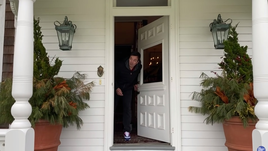 Jimmy Fallon peeks out his front door while social distancing during the coronavirus pandemic.