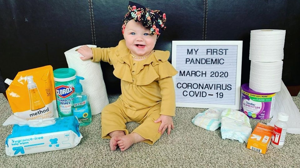 A baby's first pandemic photoshoot may not have been what these parents had planned, but they are absolultely adorable.