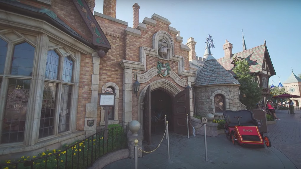 The front entrance to Mr. Toad's Wild Ride at Disneyland has a car parked out front.
