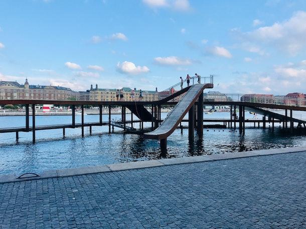 A slide goes into a canal in Copenhagen, Denmark.