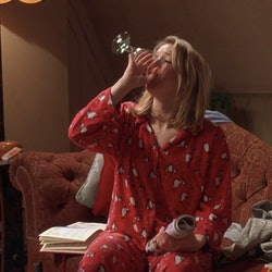 A screenshot from the film Bridget Jones' Diary where Bridget is in her pajamas drinking wine. If you're wondering if you can not shower for multiple days in a row, these doctors have the answer for you