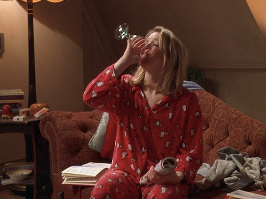 A screenshot from the film Bridget Jones' Diary where Bridget is in her pajamas drinking wine. If you're wondering if you can not shower for multiple days in a row, these doctors have the answer for you.