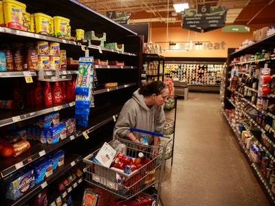 A shopper searches for food