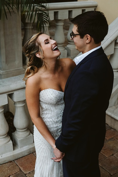 Rachel Varina in Kitty Chen gown smiles and laughs with husband on wedding day