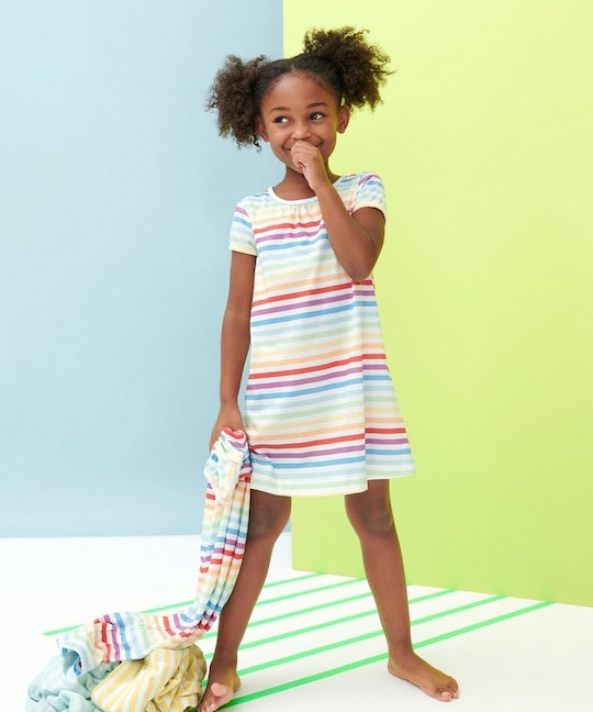 little girl wearing rainbow striped nightgown from primary
