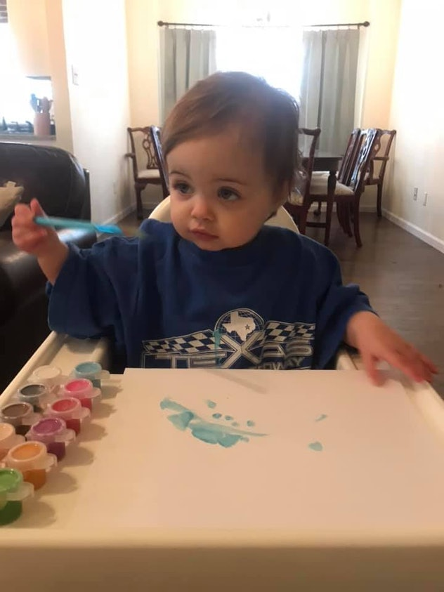 Finger painting in a high chair is one way kids are entertaining themselves during social distancing...