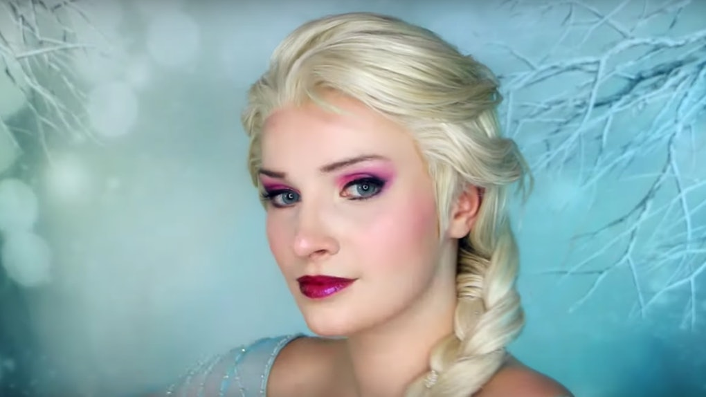 A woman wearing Elsa-inspired makeup from Disney's 'Frozen' has her hair braided like Elsa's.