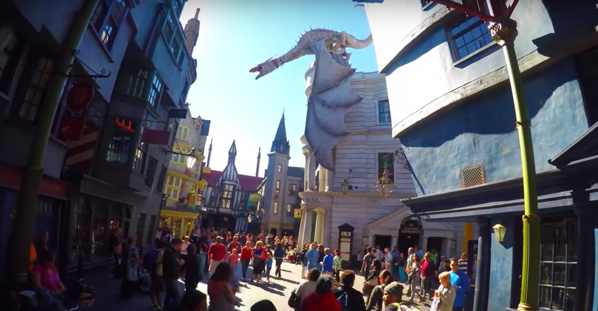 A dragon sits on top of the Harry Potter and the Escape from Gringotts Ride at the Wizarding World of Harry Potter at Universal Studios Orlando.