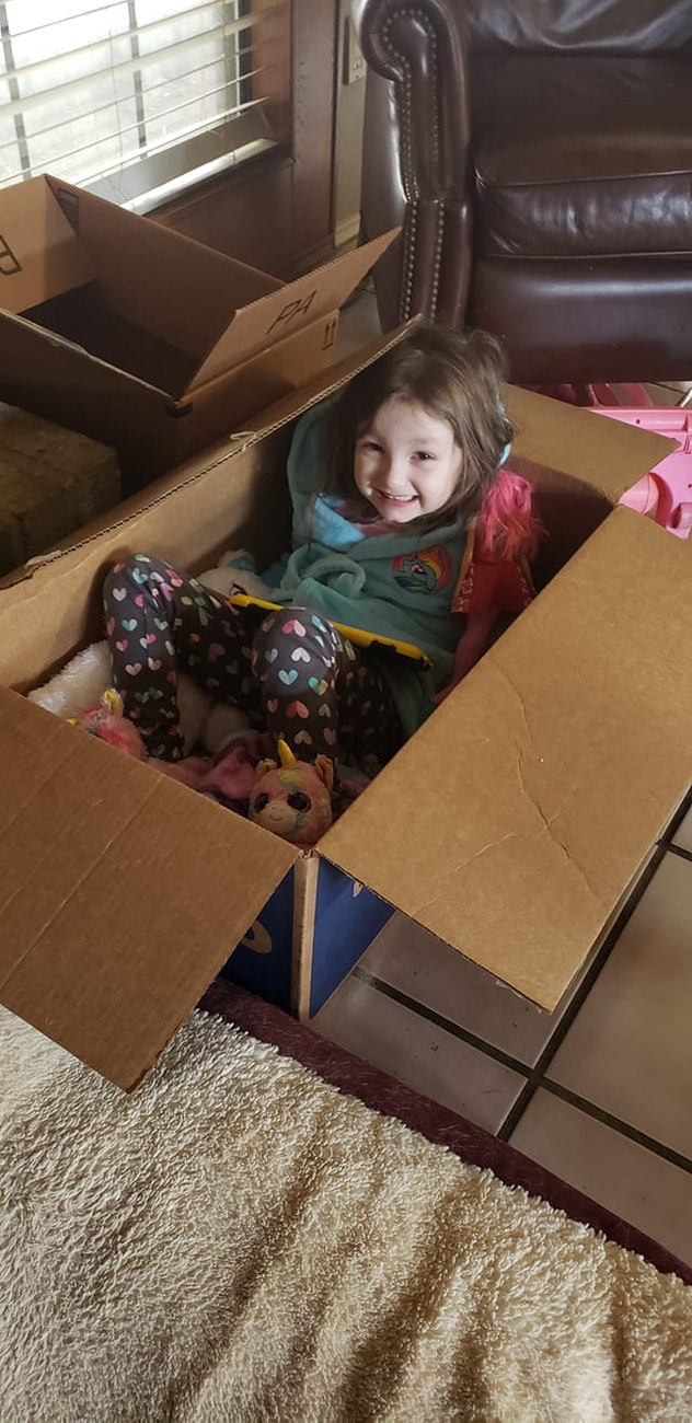 Playing in boxes is one way kids are entertaining themselves during the coronavirus pandemic.