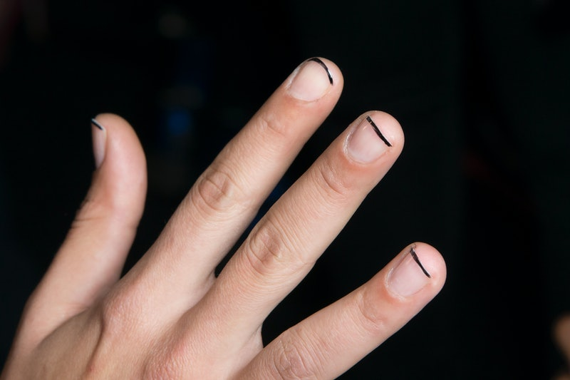 Minimalist nail art ideas, like this black line manicure, are so easy to DIY at home