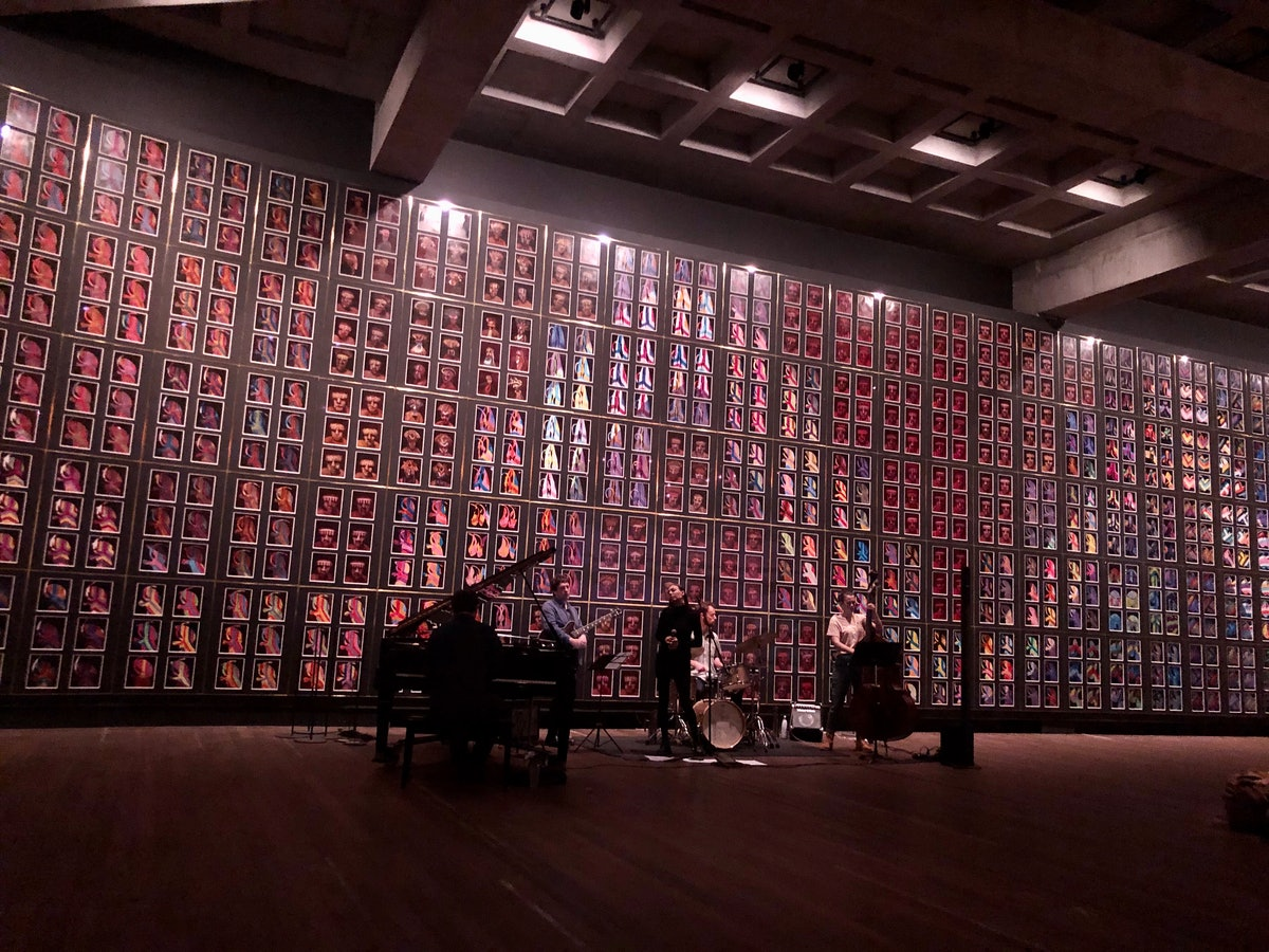 A group of musicians perform at The Museum of Old and New Art.