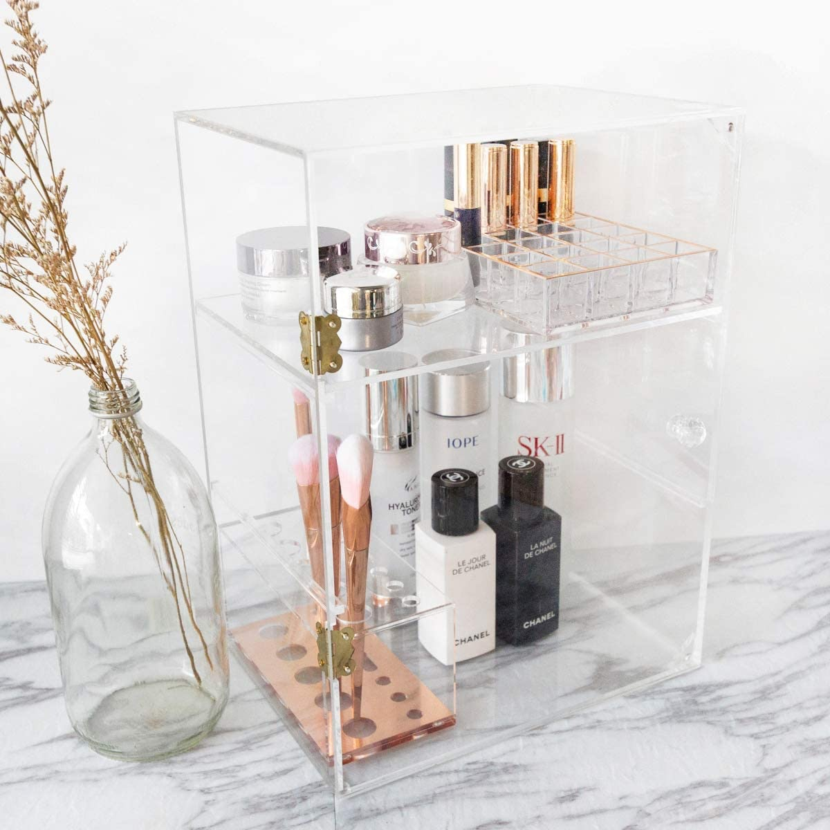 Clear acrylic beauty organizers, like the ones from Moosy Life, typically are available for $20 or l...