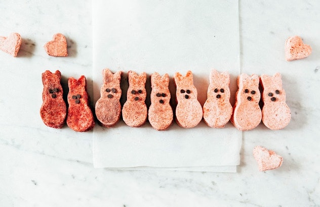 A row of homemade marshmallow peeps in an ombre red/pink lineup