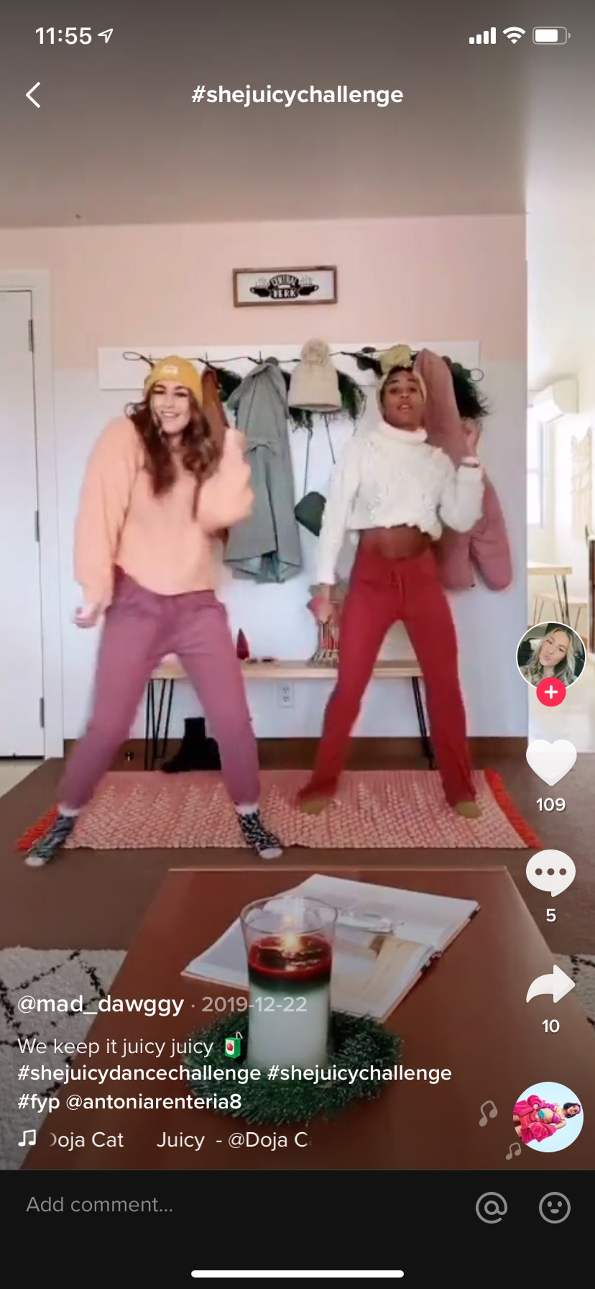 Two best friends do the #shejuicychallenge on TikTok in a colorful room.