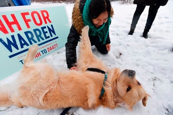 Supporters of US Presidential Candidate and Massachusetts Senator Elizabeth Warren greet her dog Bailey being escorted around the rally with her son Alexander outside of the Democratic Debate