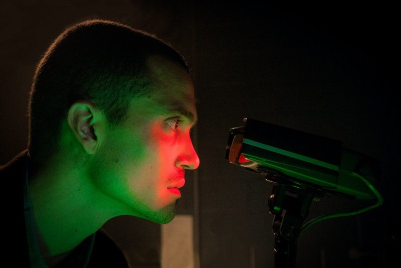 Sergei from 'Devs' looking into a high-tech machine.