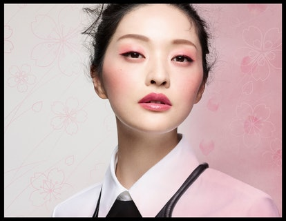 A model wears products from the new MAC Cosmetics Petal Power collection