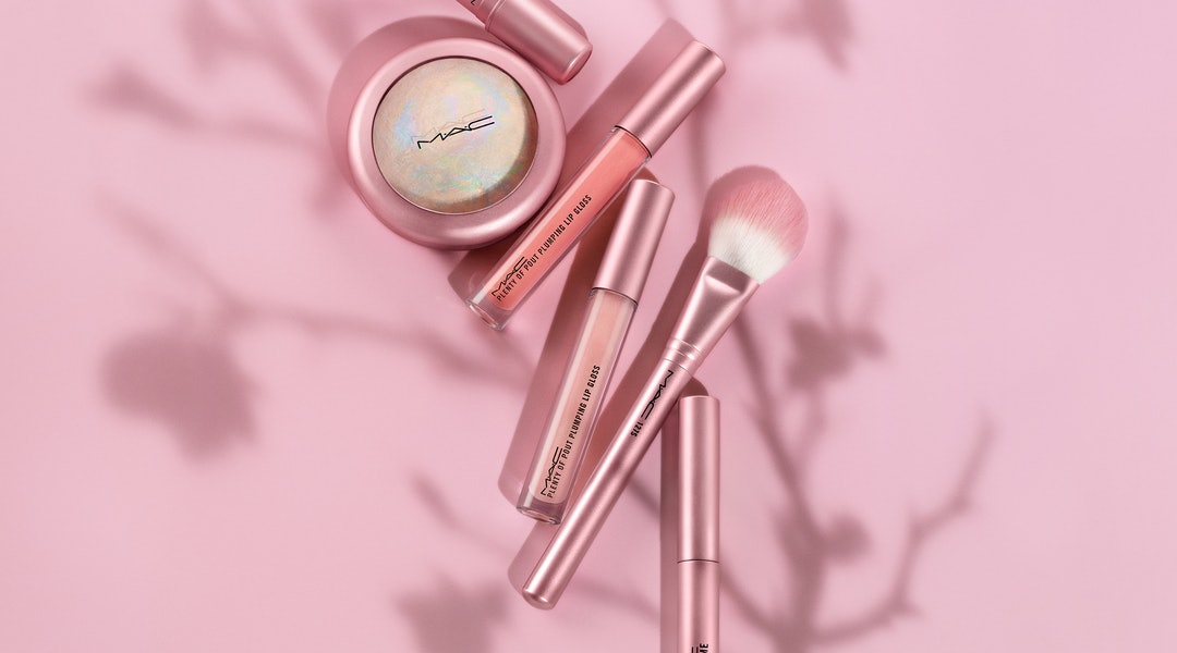 Lipstick, lip gloss, highlighter, and a makeup brush from MAC Cosmetics' new Petal Power Collection