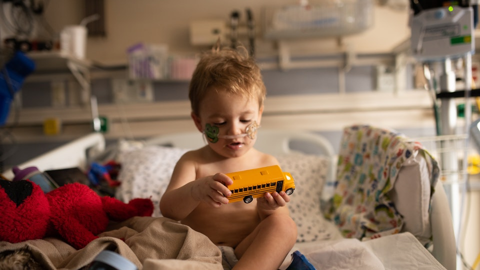 A child in hospital plays with a toy