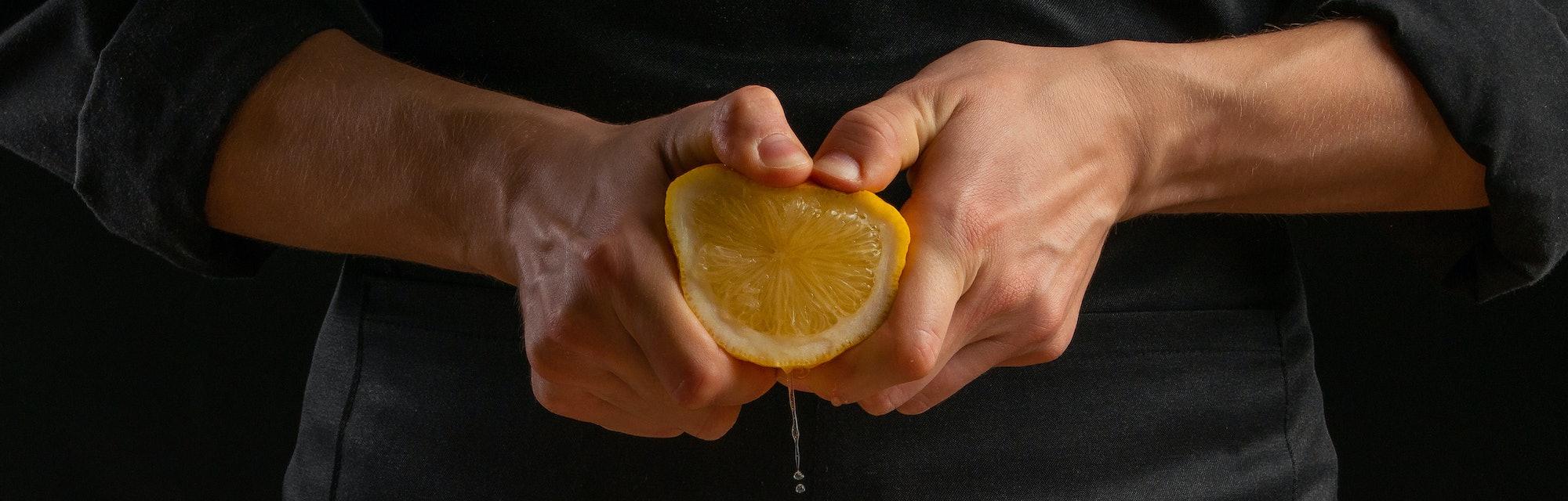 Chef squeezing lemon.