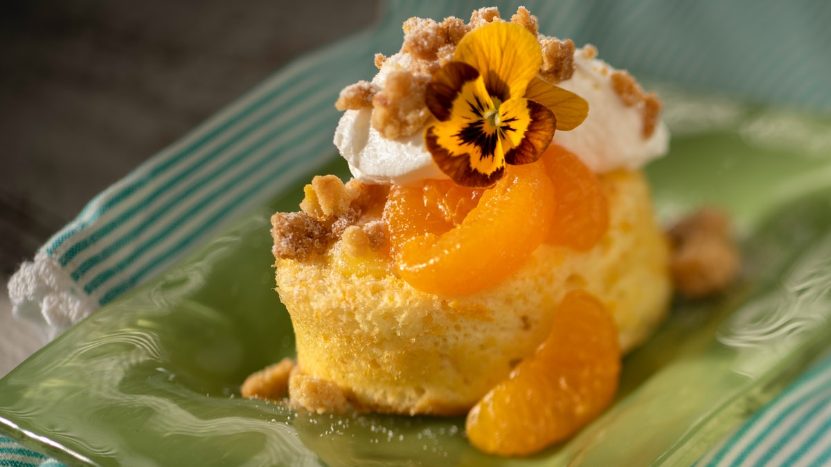 Flowers decorate a mandarin citrus dessert, which is served at the 2020 Epcot International Flower & Garden Festival at Disney.