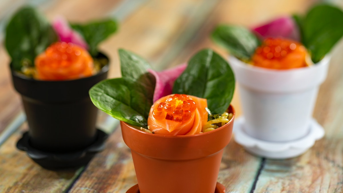 Salmon rolled up and placed in a pots, so it looks like flowers is being served at the 2020 Epcot International Flower & Garden Festival at Disney.