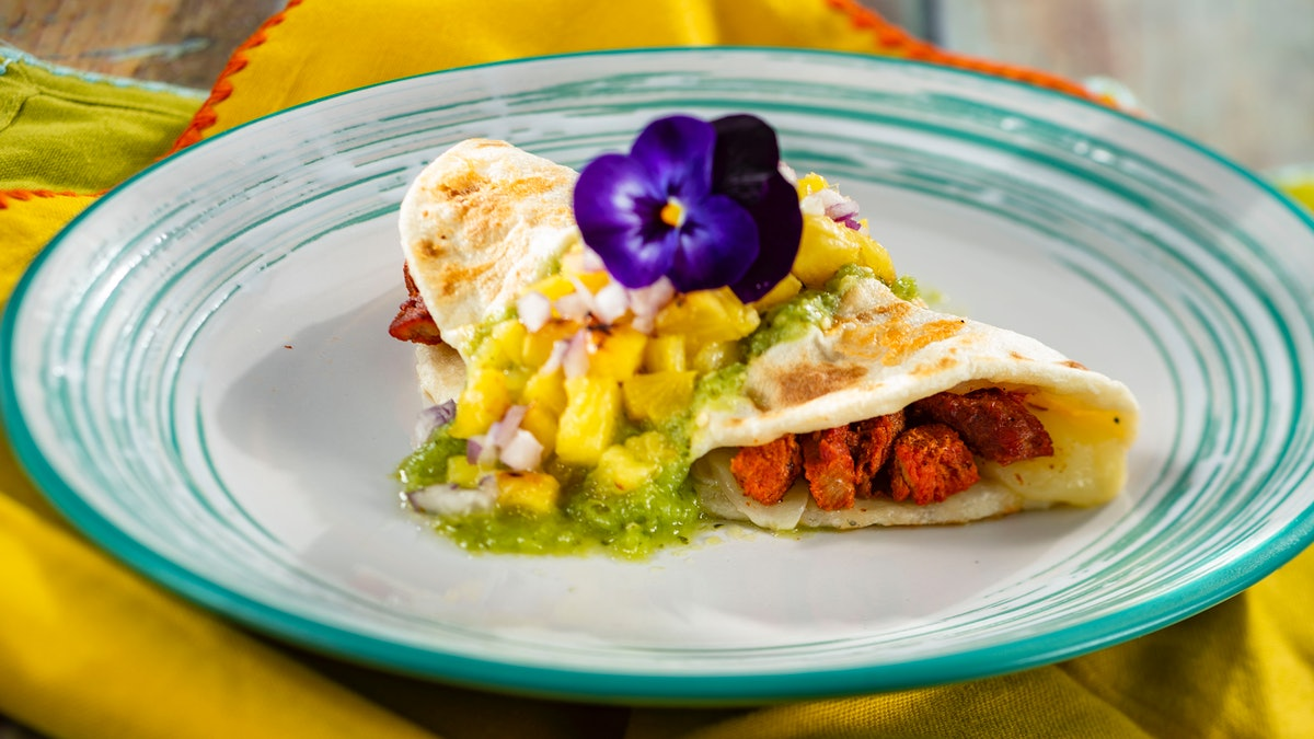 A quesadilla with flowers on top is served at the 2020 Epcot International Flower & Garden Festival at Disney.