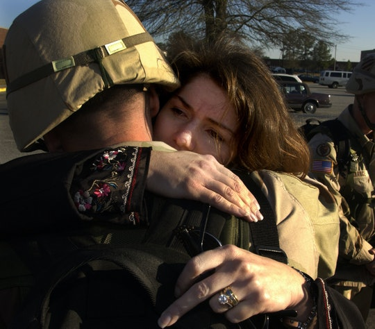 Tamara and Noel Nicolle hug each other before he deploys to Kuwait January 10, 2003 in Ft. Stewart, Georgia. Noel is a U.S. Army Lieutenant Col. with the 3rd Infantry Division Artillery headquartered at Fort Stewart, Georgia and will depart for the Middle East as part of a huge U.S. military troop build up in that area for a possible war against Iraq. The couple are newly married and are expecting their first child in June 2003.