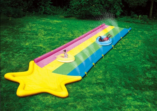 A ginormous rainbow super slide in your back yard can provide hours of fun in the sun.